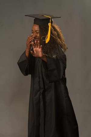 Aleea Moore taking graduation photos in her cap and gown.