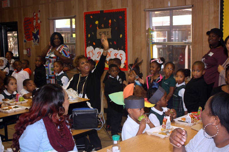 Parents and students in costume share Thanksgiving lunch at Southwest