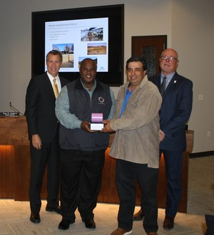 Anthony Pipkins and Charles Pino accepting an award from Eastern Municipal Water District.