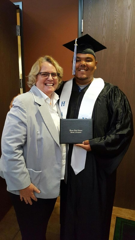 Tara O'Malley and Ray Gardner in his cap and gown at summer school graduation
