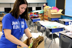 John Colemon teachers unpack their classrooms at the new John Colemon Elementary School.