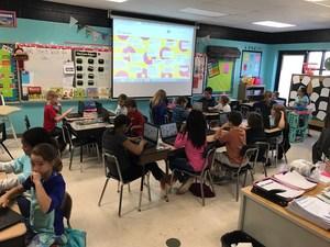 Photo of 5th grade class using technoloyg