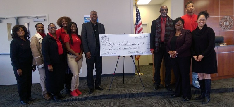The City of Baker Presents Baker School System with a Check. Thumbnail Image