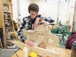TKHS senior Trevor Hodges puts a little extra love into each rocking toy.
