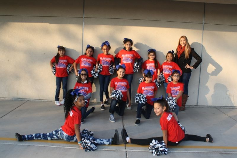An after school tutor with the Plantation Elementary cheerleading team