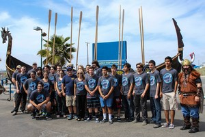 Marina High School staff, students, and community members pose for a picture in front of the Valhalla.
