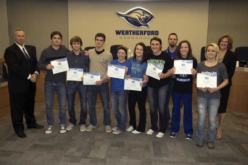 Board recognizes WHS wrestlers for advancing to regionals, state